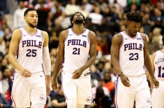 WASHINGTON, DC - JANUARY 09: Ben Simmons #25, Joel Embiid #21, and Jimmy Butler #23 of the Philadelphia 76ers look on in the second half Washington Wizards at Capital One Arena on January 09, 2019 in Washington, DC. NOTE TO USER: User expressly acknowledges and agrees that, by downloading and or using this photograph, User is consenting to the terms and conditions of the Getty Images License Agreement.   Rob Carr/Getty Images/AFP