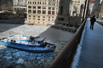 CHICAGO, ILLINOIS - JANUARY 30: The James Versluis breaks ice on the frozen Chicago River on January 30, 2019 in Chicago, Illinois. Businesses and schools have closed, Amtrak has suspended service into the city, more than a thousand flights have been cancelled and mail delivery has been suspended as the city copes with record-setting low temperatures.   Scott Olson/Getty Images/AFP