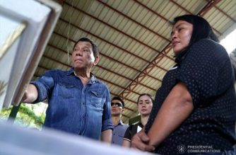 President Rodrigo Roa Duterte commiserates with the relatives of one of the victims who died during the twin bombings at the Cathedral of Our Lady of Mount Carmel in Jolo, Sulu as he visited Camp Teodulfo Bautista in Jolo on January 28, 2019. KING RODRIGUEZ/PRESIDENTIAL PHOTO