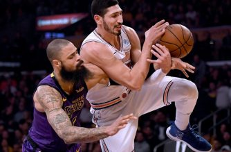 FILES: LOS ANGELES, CALIFORNIA - JANUARY 04: Enes Kanter #00 of the New York Knicks and Tyson Chandler #5 of the Los Angeles Lakers go for a rebound during the first quarter at Staples Center on January 04, 2019 in Los Angeles, California. NOTE TO USER: User expressly acknowledges and agrees that, by downloading and or using this photograph, User is consenting to the terms and conditions of the Getty Images License Agreement. Harry How/Getty Images/AFP  Harry How / GETTY IMAGES NORTH AMERICA / AFP