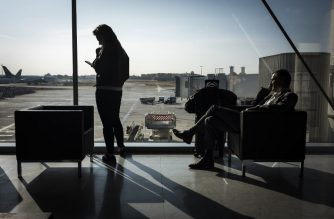 Travellers wait for their flight at the Paris-Orly airport on October 10, 2018. (Photo by Lionel BONAVENTURE / AFP)