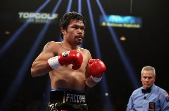 (FILES) In this file photo taken on January 19, 2019 Manny Pacquiao is in the ring during the WBA welterweight championship against Adrien Broner at MGM Grand Garden Arena in Las Vegas, Nevada. - Filipino boxing icon Manny Pacquiao might have suffered a potentially career-ending detatched retina in his left eye in beating Adrien Broner on Saturday, the New York Daily News reported on January 21, 2019. Pacquiao was set to fly home to the Philippines on Monday for an exam by an eye specialist, according to the newspaper, which cited two unnamed sources from Pacquiao's camp with different takes on the injury. (Photo by Christian Petersen / GETTY IMAGES NORTH AMERICA / AFP)