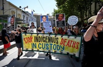 "People hold up placards of Aboriginal people who have allegedly died in police custody, as they take part in an ""Invasion Day"" rally on Australia Day in Melbourne on January 26, 2019. - Thousands of people joined rallies across Australia calling for equal rights for indigenous people and for an end to the celebration of Australia Day on January 26, which marks the official declaration of British sovereignty on the land that eventually became Australia. (Photo by PETER PARKS / AFP)"