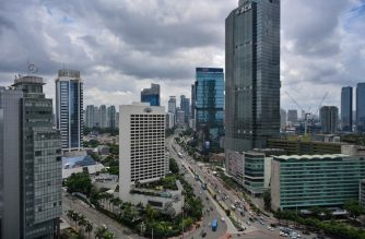 Buildings are seen along Sudirman Street, Jakarta's main thoroughfare, on January 30, 2019. (Photo by BAY ISMOYO / AFP)