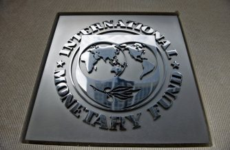 (FILES) In this file photo taken on June 30, 2015 a logo is seen outside the headquarters of the International Monetary Fund in Washington, DC. - The International Monetary Fund board on February 4, 2019 approved a $2 billion loan payment to Egypt, the latest in the country's three-year aid program. The latest installment brings the total paid to Cairo to about $10 billion since the loan deal was signed in November 2016. The previous loan tranche was approved in July of last year but this fourth review of Egypt's program had been awaiting board approval since October, when IMF staff and government officials had finalized it. (Photo by Brendan SMIALOWSKI / AFP)