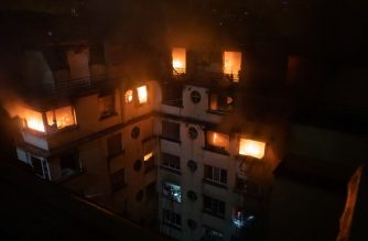 """This handout picture taken and released by the Paris firefighters brigade in the night of February 5, 2019 shows a fire in a building in Erlanger street in the 16th arrondissement in Paris, that killed 8 people. - A woman has been arrested over a deadly blaze that killed eight people in Paris and police are treating the fire as a possible arson attack, a prosecutor said early on February 5. (Photo by HO / BSPP - Brigade de sapeurs-pompiers de Paris / AFP) / RESTRICTED TO EDITORIAL USE - MANDATORY CREDIT """"AFP PHOTO / BSPP"""" - NO MARKETING NO ADVERTISING CAMPAIGNS - DISTRIBUTED AS A SERVICE TO CLIENTS ---"""