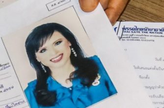 An official of Raksa Chart party submitting the registration document of Thai Princess Ubolratana bearing her photograph to election commission officials in Bangkok on February 8, 2019. - Thai Princess Ubolratana will run for prime minister in upcoming elections with a party tied to the divisive Shinawatra political family, an official said February 8, a shock twist that deals a blow to the ruling junta's hopes of holding onto power. (Photo by Chin CHOMDEE / THAI NEWS PIX / AFP)