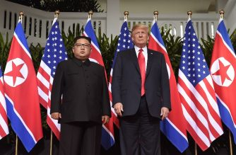 (FILES) This file photo taken on June 12, 2018 shows US President Donald Trump (R) posing with North Korea's leader Kim Jong Un (L) at the start of their historic US-North Korea summit, at the Capella Hotel on Sentosa island in Singapore. - US President Donald Trump announced February 8, 2019, that his upcoming summit with North Korean leader Kim Jong Un will take place in Hanoi on February 27 and 28. The US State Department announced February 8, 2019, that the special US envoy for North Korea will meet again with Pyongyang  officials before a second summit between President Donald Trump and Kim Jong Un -- hours after he returned to Seoul from talks in the North on the summit's agenda. (Photo by SAUL LOEB / AFP)