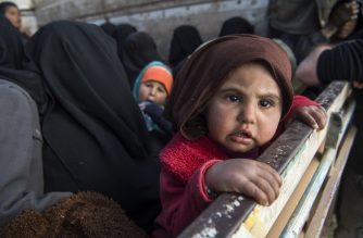 "Women and children fleeing from the last Islamic State group's tiny pocket in Syria sit in the back of a truck near Baghuz, eastern Syria, on February 11, 2019. - US-backed Syrian Democratic Forces (SDF) fighters battled a fierce jihadist fightback on February 11, as they pushed to retake a last morsel of territory from the Islamic State group. More than four years after the extremists declared a ""caliphate"" across large parts of Syria and neighbouring Iraq, several offensives have whittled that proto-state down to a tiny holdout. (Photo by Fadel SENNA / AFP)"