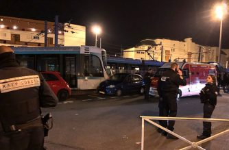 Emergency personnel gather at the scene of a collision between two trams at Issy-les-Moulineaux, south-west of Paris on February 11, 2019. - Two trams collided in Issy-les-Moulineaux (Hauts-de-Seine), causing ten light injuries according to reports from local authorities. (Photo by Philippe DUPEYRAT / AFP)