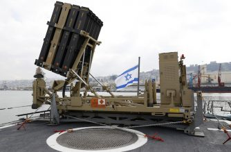 A photo taken on February 12, 2019, shows an Israeli naval Iron Dome defence system, designed to intercept and destroy incoming short-range rockets and artillery shells, installed on a Sa'ar 5 Lahav Class corvette of the Israeli Navy fleet, in the northern  port of Haifa. (Photo by JACK GUEZ / POOL / AFP)