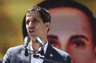 Venezuelan opposition leader and self declared acting president Juan Guaido speaks to supporters during a rally to press the military to let in US humanitarian aid, in eastern Caracas on February 12, 2019. - The tug of war between the government and opposition is centred on whether humanitarian aid will be allowed into the economically crippled country, which suffers shortages of food, medicine and other basics. (Photo by Federico PARRA / AFP)