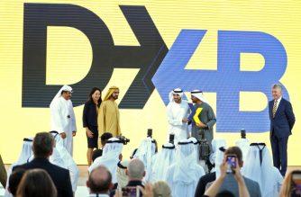 Ruler of Dubai Sheikh Mohammed bin Rashid Al-Maktoum (2-L), and the Emirate's Crown Prince Sheikh Hamdan bin Mohammed bin Rashid Al-Maktoum (3-R), participate in ceremony to present the new logo of Dubai Airoprt, in Dubai, on February 13, 2019. (Photo by KARIM SAHIB / AFP)