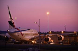 A picture taken on February 14, 2019 in Toulouse shows an Emirates' airline Airbus A380 parked in front of Airbus plant, as European aerospace giant announced it would end production of the A380 superjumbo. - European aerospace giant Airbus said on February 14 it would end production of the A380 superjumbo, the double-decker jet which earned plaudits from passengers but failed to win over enough airlines to justify its massive costs. (Photo by REMY GABALDA / AFP)
