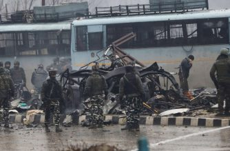 "Indian security forces inspect the remains of a vehicle following an attack on a paramilitary Central Reserve Police Force (CRPF) convoy that killed at least 16 troopers and injured several others near Awantipur town in the Lethpora area of Kashmir about 30km south of Srinagar on February 14, 2019. - At least 16 Indian soldiers were killed on February 14 in Indian-administered Kashmir in the deadliest attack on government forces in more than two years, police said. Kashmir has been divided between India and Pakistan since independence. Rebels have been fighting for an independent Kashmir, or a merger with Pakistan, for 30 years. (Photo by STR / AFP) / ""The erroneous mention[s] appearing in the metadata of this photo by STR has been modified in AFP systems in the following manner: [vehicle] instead of [bus]. Please immediately remove the erroneous mention[s] from all your online services and delete it (them) from your servers. If you have been authorized by AFP to distribute it (them) to third parties, please ensure that the same actions are carried out by them. Failure to promptly comply with these instructions will entail liability on your part for any continued or post notification usage. Therefore we thank you very much for all your attention and prompt action. We are sorry for the inconvenience this notification may cause and remain at your disposal for any further information you may require."""