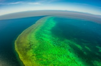 "A handout photo taken by Matt Curnock on February 13, off Townsville. 2019 and released on February 15 shows sediment (top) approaching Central Great Barrier Reef from recent unprecedented rain and flooding around Cape Cleveland, off Townsville. - Runoff from recent floods in northern Australia is flowing onto parts of the Barrier Reef, scientists said on February 14, starving coral of light and providing fodder for the predatory crown-of-thorns starfish. (Photo by MATT CURNOCK / Matt Curnock / AFP) / --EDITORS NOTE--- RESTRICTED TO EDITORIAL USE - MANDATORY CREDIT ""AFP PHOTO / Matt Curnock"" - NO MARKETING - NO ADVERTISING CAMPAIGNS - DISTRIBUTED AS A SERVICE TO CLIENTS - NO ARCHIVES"