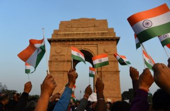 Indian demonstrators wave the national flag as they shout slogans against Pakistan during a protest at India Gate in New Delhi on February 17, 2019, after an attack on a paramilitary Central Reserve Police Force (CRPF) convoy in the Lethpora area of Kashmir. - India and Pakistan's troubled ties risked taking a dangerous new turn on February 15 as New Delhi accused Islamabad of harbouring militants behind one of the deadliest attacks in three decades of bloodshed in Indian-administered Kashmir. (Photo by SAJJAD HUSSAIN / AFP)