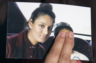(FILES) In this file photo taken on February 22, 2015 Renu Begum, eldest sister of missing British girl Shamima Begum, holds a picture of her sister while being interviewed by the media in central London. - A teenager who joined the Islamic State group in Syria but now wants to return to Britain gave birth on February 17, 2019, drawing fresh scrutiny as Europe struggles with Western jihadist supporters eager to return home. (Photo by LAURA LEAN / POOL / AFP)