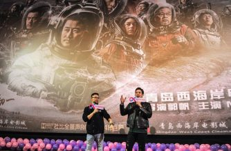 "This photo taken on February 17, 2019 shows film director Guo Fan (L) and American actor Michael Stephen Kai Sui attending a promotional event for Chinese sci-fi film ""The Wandering Earth"" in Qingdao in China's eastern Shandong province. - China's first large-scale sci-fi blockbuster has become the country's second highest-grossing movie ever, while claiming the Chinese film box-office champion in North America in the past five years. (Photo by STR / AFP) / China OUT / CHINA OUT TO GO WITH AFP STORY: Blockbuster-China-sci-fi-film-entertainment, by  Kelly WANG"