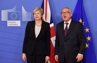 European Commission President Jean-Claude Juncker (R) welcomes British Prime Minister Theresa May (L) as she arrives at the EU headquarters in Brussels to hold a meeting on Brexit talks on February 20, 2019. (Photo by EMMANUEL DUNAND / AFP)