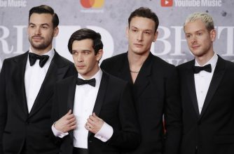 British band 'The 1975', Matthew Healy, Ross MacDonald, George Daniel and Adam Hann pose on the red carpet on arrival for the BRIT Awards 2019 in London on February 20, 2019. (Photo by Tolga AKMEN / AFP) / RESTRICTED TO EDITORIAL USE – NO POSTERS – NO MERCHANDISE– NO USE IN PUBLICATIONS DEVOTED TO ARTISTS