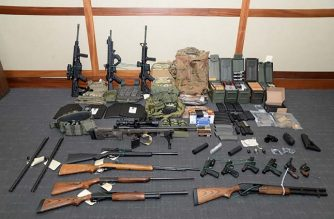 "This undated image released by the US Attorney's Office on February 20, 2019, shows weapons seized at the Silver Spring, Maryland, home of US Coast Guard officer Christopher Paul Hasson. - Hasson, who espoused white supremacist views and drafted a target list of Democratic politicians and prominent media figures, has been arrested on firearms and drug charges. Hasson, an admirer of Norwegian mass murderer Anders Breivik, was arrested last week and a powerful arsenal seized from his home, according to court documents unsealed on February 20. ""The defendant intends to murder innocent civilians on a scale rarely seen in this country,"" US District Attorney Robert Hur said in a motion seeking that Hasson be detained until trial. (Photo by HO / AFP) / RESTRICTED TO EDITORIAL USE - MANDATORY CREDIT ""AFP PHOTO / US Attorney's Office"" - NO MARKETING NO ADVERTISING CAMPAIGNS - DISTRIBUTED AS A SERVICE TO CLIENTS"