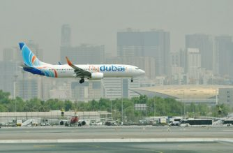 A picture take on September 14, 2017 shows a FlyDubai Boing 737-800 landing at the tarmac at Dubai's International Airport. (Photo by GIUSEPPE CACACE / AFP)