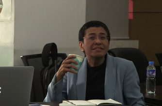 "Philippine journalist Maria Ressa, whose news site has repeatedly clashed with President Rodrigo Duterte, sits in an office at the National Bureau of Investigation after being charged with ""cyber libel.""  (Photo grabbed from AFPTV video/Courtesy Agence France Presse)"