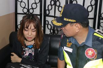 NCRPO chief Guillermo Eleazar speaks to Jian Zhale after the taho-throwing incident on Saturday, Feb. 9./NCRPO/