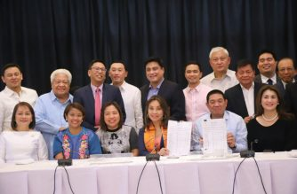 Congressional bicameral conference committee members pose for a photo showing the final version of the 2019 national budget.  (Photo courtesy twitter post of Senator Loren Legarda)