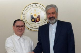 Foreign Affairs Secretary Teodoro Locsin Jr. and Iran's Deputy Foreign Minister pose for a picture at the Department of Foreign Affairs on Thursday, Feb. 22./DFA/ (Crop of DFA photo/Courtesy DFA)