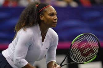 ASHEVILLE, NC - FEBRUARY 11: Serena Williams of Team USA waits on a serve from Lesley Kerkhove and Demi Schuurs of the Netherlands during a doubles match in the first round of the 2018 Fed Cup at US Cellular Center on February 11, 2018 in Asheville, North Carolina.   Richard Shiro/Getty Images/AFP