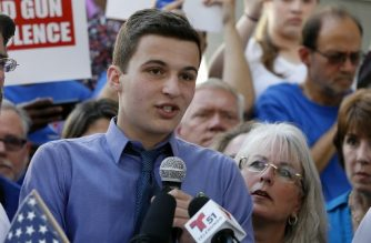 """(FILES) In this file photo taken on February 17, 2018 Marjory Stoneman Douglas High School student Cameron Kasky speaks at a rally for gun control at the Broward County Federal Courthouse in Fort Lauderdale, Florida.  Students who survived a mass shooting at their Florida school on February 18, 2018 announced plans to march on Washington in a bid to """"shame"""" lawmakers into reforming laws that make powerful firearms readily available. The """"March for our Lives"""" will take place on March 24, with sister marches planned across the country, a group of students told ABC News, vowing to make Wednesday's shooting a turning point in America's deadlocked debate on gun control.Singling out the links between politicians and the powerful National Rifle Association, fellow student Cameron Kasky said any politician """"who is taking money from the NRA is responsible for events like this.""""  / AFP PHOTO / RHONA WISE"""