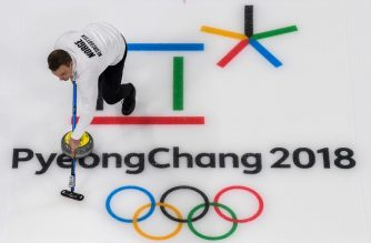 Norway's  Magnus Nedregotten brushes the ice surface during the curling mixed doubles bronze medal game during the Pyeongchang 2018 Winter Olympic Games at the Gangneung Curling Centre in Gangneung on February 13, 2018. / AFP PHOTO / Vincent AMALVY