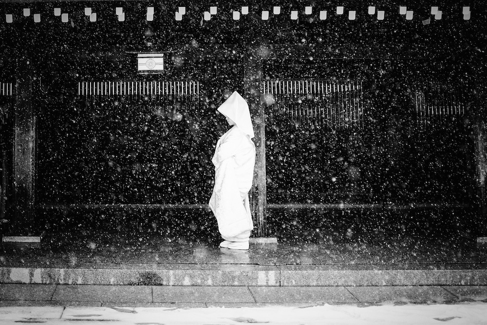 Brave bride getting wed in the only day of snow in Tokyo, winter 2014.
