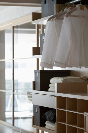 Linen on shelves in contemporary furniture store bedroom
