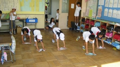 Japanese school kids cleaning their classroom