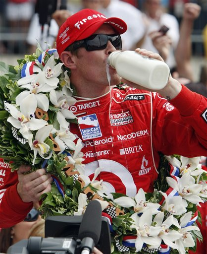 Scott Dixon, of New Zealand, drinks milk after winning the Indianapolis 500 auto race Sunday, May 25, 2008, at Indianapolis Motor Speedway in Indianapolis. (AP Photo/Darron Cummings)