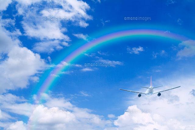 飛行機と空にかかる虹(c)KIYOTSUGU ...