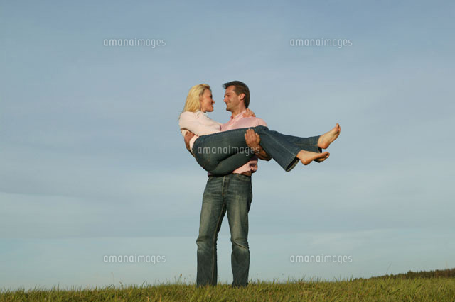Man carrying woman in park 20025266336