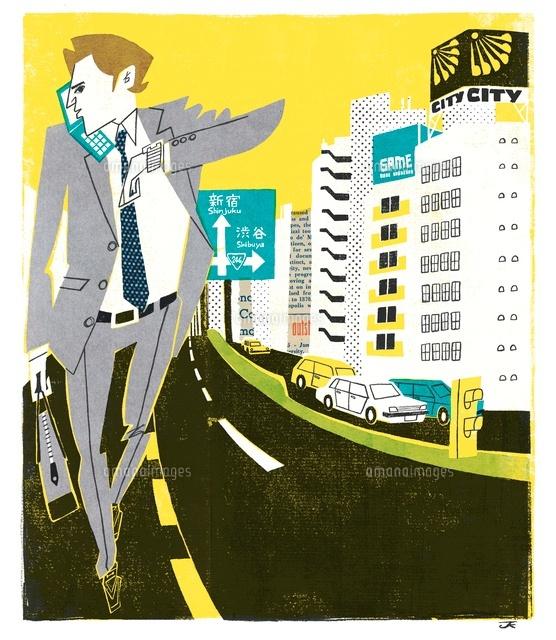 携帯で話しながら歩くビジネスマン (c)岸潤一/WAHA