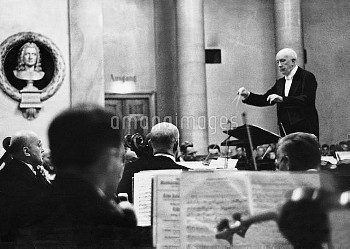 Germany The composer Richard Strauss (1864-1949) at the conductor's stand. Richard Strauss, 1930