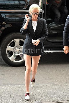 Kristen Stewart shows off her long legs as she wears a double-breasted jacket and very little else o
