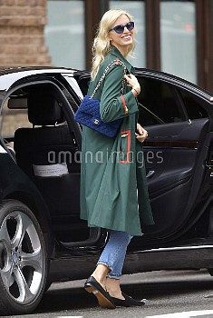 Karolina Kurkova wears a blue Chanel shoulder bag and a spring jacket while out and about in Tribeca