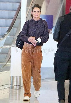 EXCLUSIVE: A relaxed Katie Holmes arrives at Toronto airport in comfy corduroy sweat pants and a kni