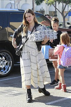 Pregnant Jessica Alba and her daughters Honor and Haven attend a birthday party at a french restaura