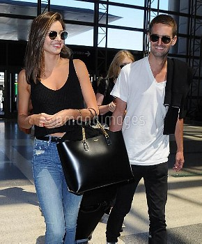 Miranda Kerr Catches A Flight At LAX With Her New Boyfriend Evan Spiegel