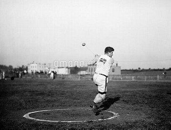 DUNCAN GILLIS (1883-1965). Canadian Olympic athlete. Photographed during the Hammer throw event at t