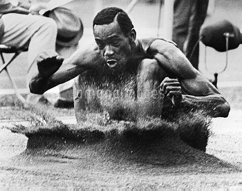 ROBERT BEAMON (1946- ). American athlete. Beamon competing in and winning the long jump event at the