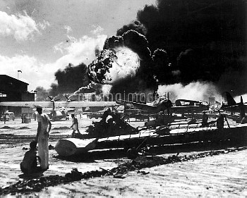 WORLD WAR II: PEARL HARBOR. Wreckage at an air station after the Japanese attack on 7 December 1941.